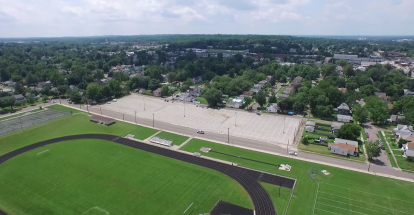 Riley High School track, field, and student parking lot